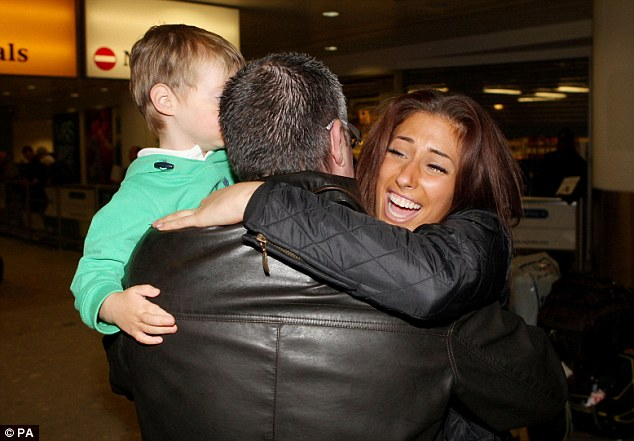 Daddy! Stacey Solomon leaps into her father David's arms as she arrived back into the UK from Australia this morning
