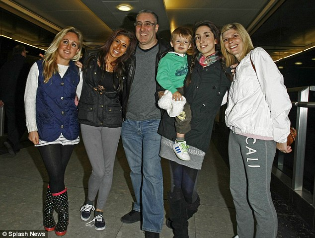 Reunited: Stacey, looking very tanned, poses with her stepsister, father David, son Zach, sister Jemma and mother Fiona