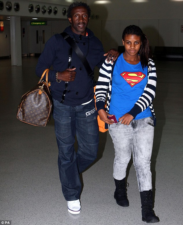 Homeward bound: Linford Christie arrives in London with daughter Brianna who travelled out to Australia with him
