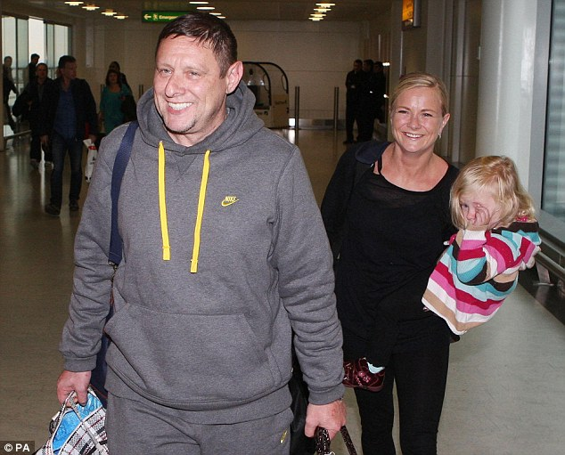 Happy Tuesday: Runner-up Shaun Ryder looked pleased to be home as he arrived at Heathrow with wife Joanne and daughter Pearl