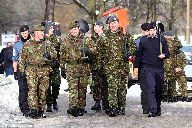 To the rescue: Members of the armed forces share a joke as they get to work in Edinburgh