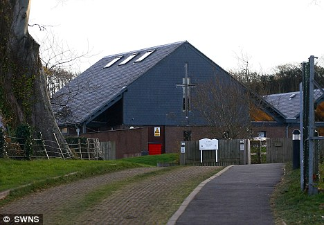 Religious studies: A female teacher at St Helen's Church of England School in Abbotsham, Devon (pictured) has been reprimanded after she accidentally played a pornographic film to pupils
