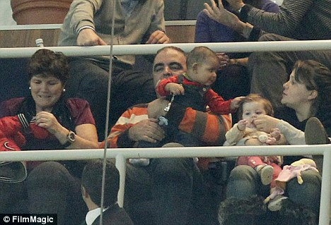 Spectator: The youngster, who was born to an unnamed American mother, was being held by Jose Andrade, the boyfriend of Ronaldo's mother Dolores Aveiro (L)