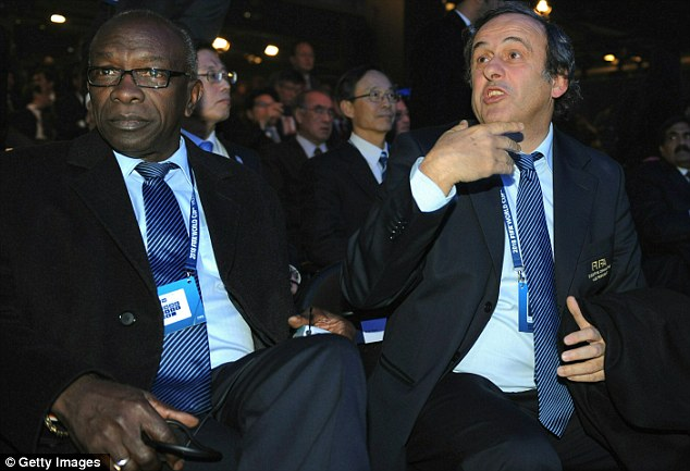 Hitting out: FIFA vice-president Jack Warner, flanked by UEFA president Michel Platini (R), was angered by media claims