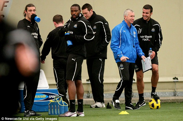 All behind the boss: Pardew shares a joke with his Newcastle players