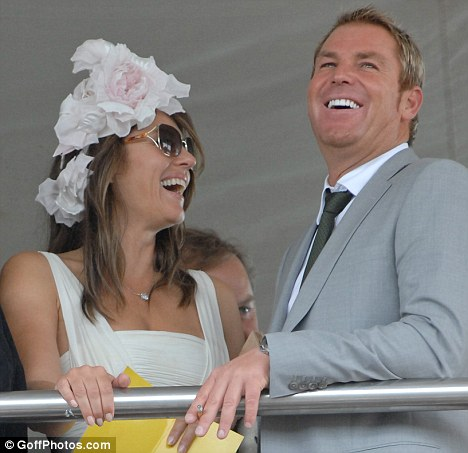 Funny business: Liz and Shane share a joke at Glorious Goodwood, where Liz was watching the fortunes of a horse she has a share in