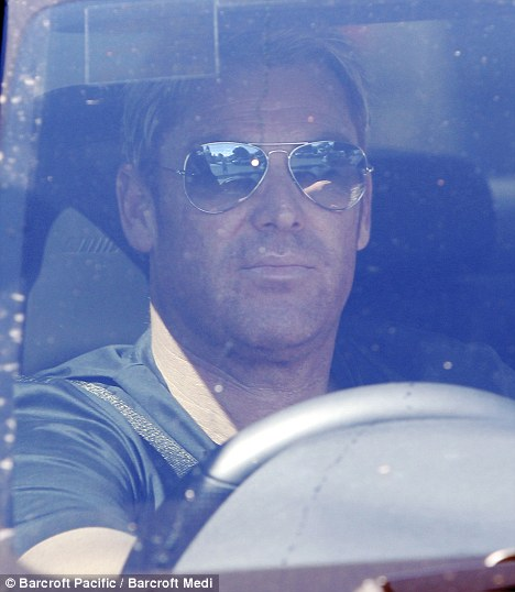 Back in Oz: Cricketer Shane Warne leaves his home in Melbourne yesterday