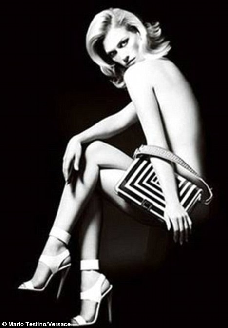 January Jones strips down for Versace's new spring/summer 2011 ad campaign.