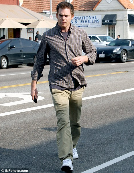 Serious: Michael C Hall looked solemn as he left a trendy West Hollywood cafe yesterday afternoon