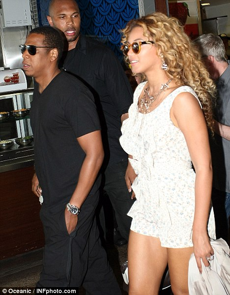 Summer time: Beyonce looked to be taking advantage of the Sydney sunshine in a floral playsuit