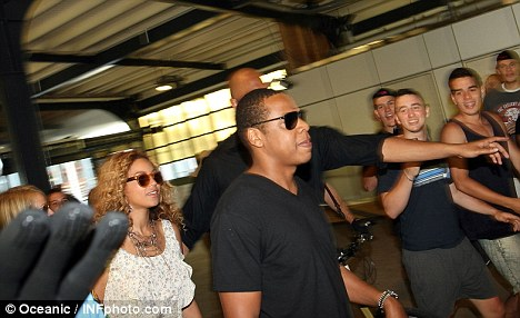 Star commuters: The superstars arrived at the beachside restaurant by ferry after a 40-minute journey from the city