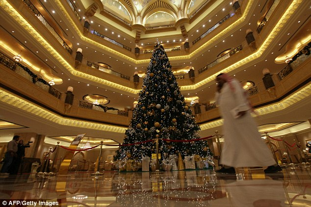 Glitzy: The 40ft tree is decked out in jewellery, including diamonds and emeralds, as well as traditional decorations