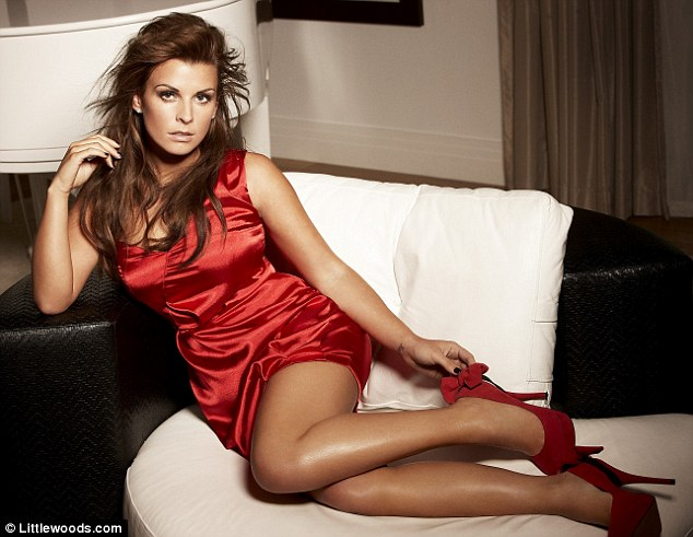 Red devil: Coleen Rooney modelling the Christmas and New Year party wear collection for Littlewoods.com - with a dress in her husband Wayne's Manchester United colours