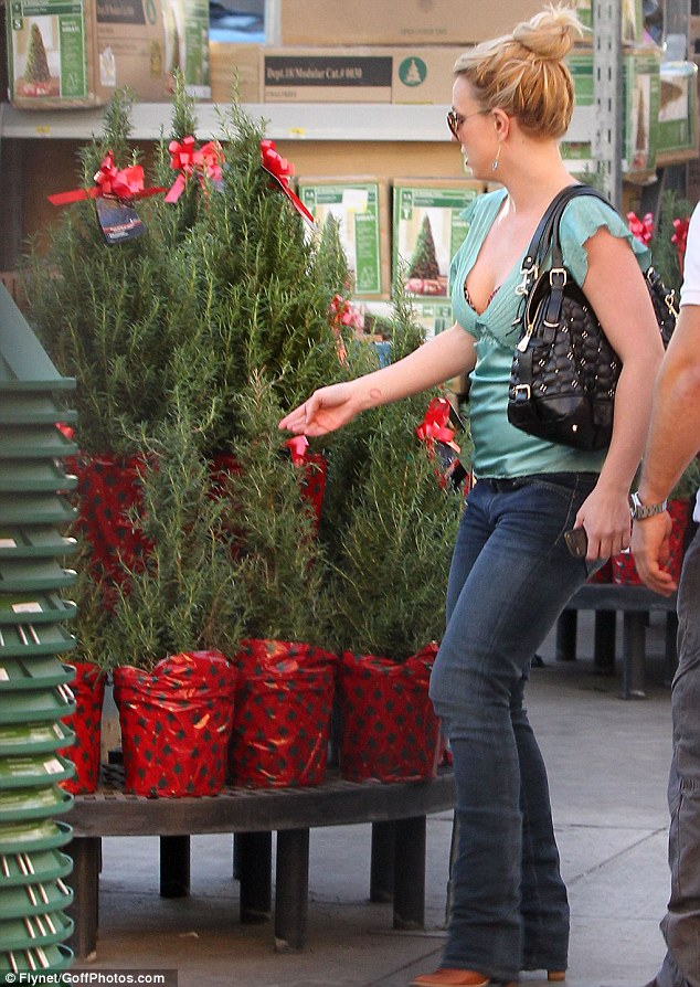 Adding to the festivities: Spears was also spotted checking out the mini Christmas trees along with other decorations