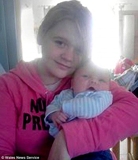 Growing up fast: April Webster, 14, with five-week-old Jamie Fishbourne