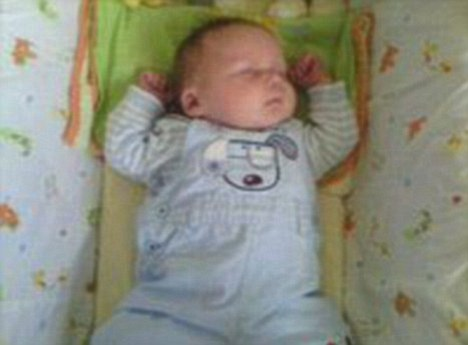 Baby Jamie: Blissfully unaware of the fact he's got the country's youngest mum and dad