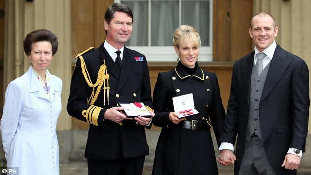 Tindall with Zara and her mother Princess Anne and step-father Vice Admiral Timothy Laurence at Buckingham Palace