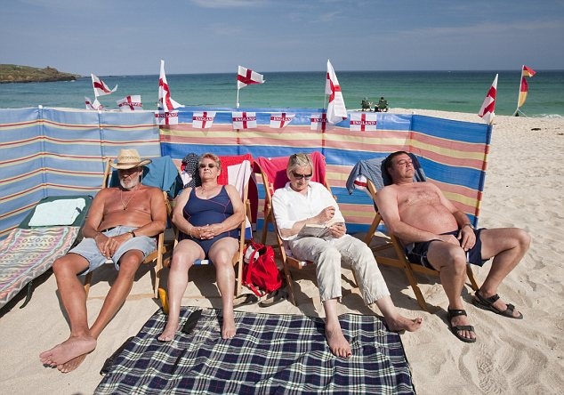 World cup England supporters sunbathing on the beach at St Ives, Cornwall, UK
