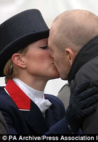 2007: Zara kisses Mike after riding her horse, Toytown, in the dressage at the Badminton Horse Trials. She had to withdraw from the competition over injury fears for Toytown