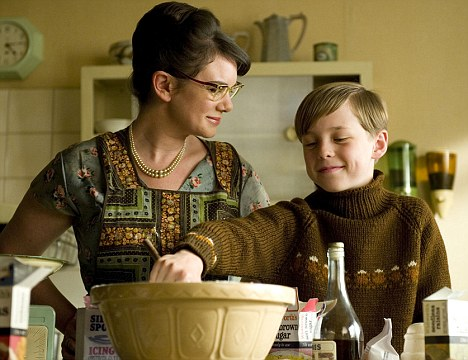 Sweet memories: A young Nigel (Oscar Kennedy) bakes with his mother (Victoria Hamilton) in the TV adaptation of Toast