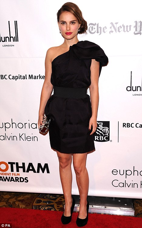 No telling: Portman hid any sign of a burgeoning bump under a loose-fitting black dress at the Gotham Film Awards a few weeks ago