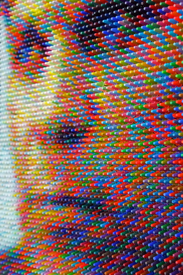 Pixelated? Thousands of wax crayons make up a picture of someone's face