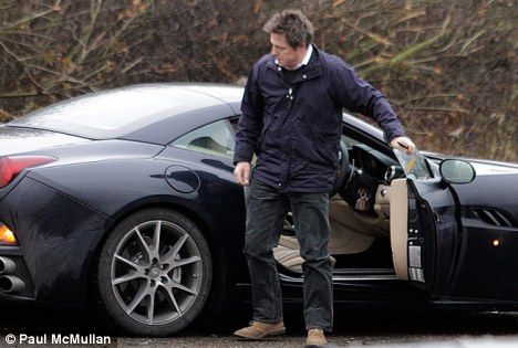 Four wheels and a breakdown: Hugh Grant was on the busy A256 near Sandwich in Kent when his car conked out