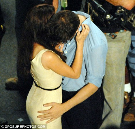 Passionate: Kristen and Rob filmed honeymoon scenes that included a kiss on the streets of Rio