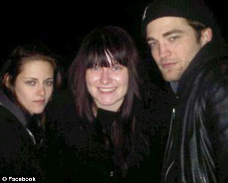 Happy fan: Robert Pattinson and Kristen Stewart celebrated New Year's Eve in The Spyglass pub and posed for pictures with Hattie Bury
