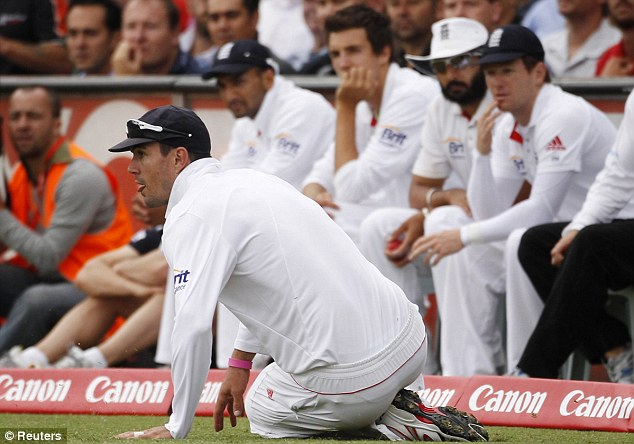 Run saver: KP -watched by his team-mates - slides down to prevent a boundary