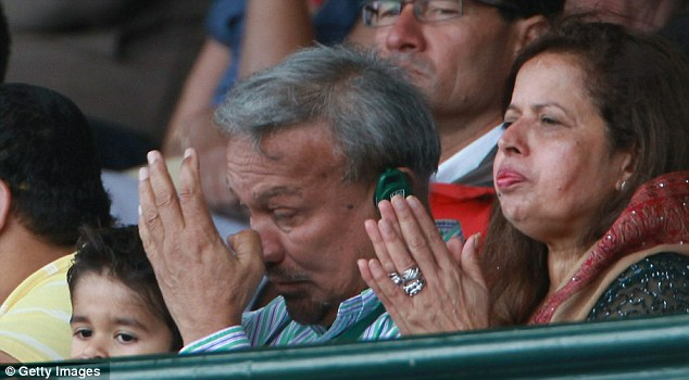 Go on, my son: Khawaja's parents look on nervously as their son makes his debut
