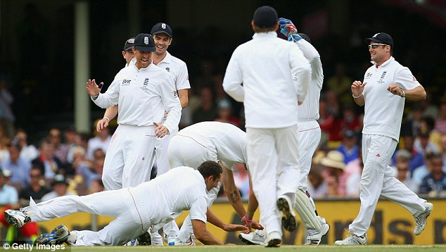 Down they go! KP and Bresnan collide as they celebrate taking the Clarke's wicket