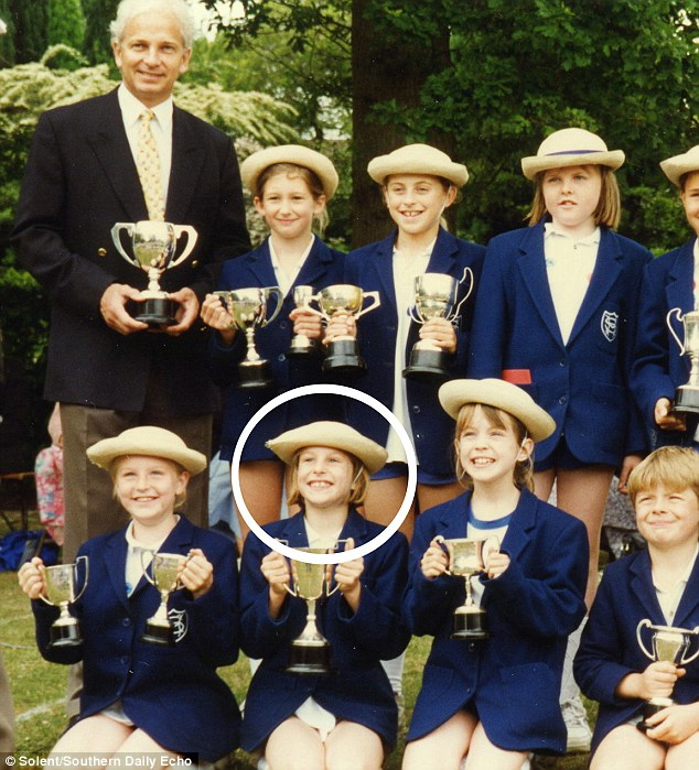 Proud: An 11-year-old Jo, circled, holds a trophy during a sports day at Sherborne House School, Hampshire, with cricket star David Gower. Emma Streatfield, pictured standing next to Mr Gower, said Jo 'was always in good spirits'r