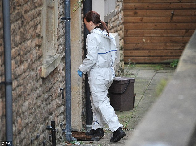 Investigation: A forensic officer enters the flat where Jo lived with her boyfriend Greg