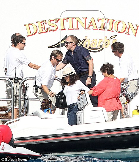 Shipshape: Salma, Francois-Henry (in blue) and Valentina get on a motorboat after visiting celebrity friends Jason Statham and his girlfriend Rosie Huntington Whiteley on Sunday