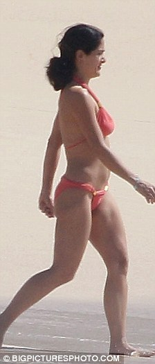 Bottoms up: The star looked trim, relaxed and make-up free as she enjoyed her time on the deserted beach