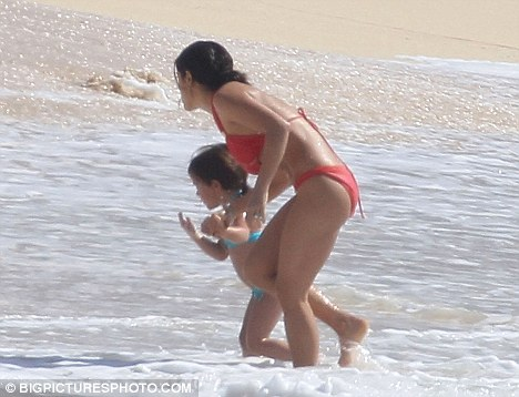Yummy mummy: The Frida actress played with her daughter Valentina in the surf