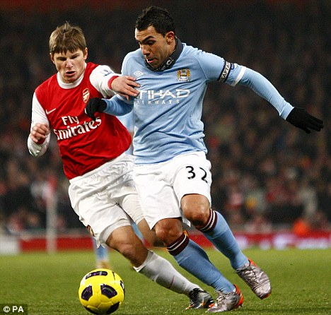 Dead end: Neither Manchester City's Carlos Tevez (right) nor Arsenal's Andrey Arshavin could find a way through at the Emirates
