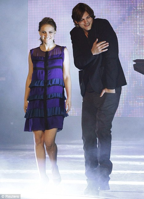 Hiding her bump: Pregnant Natalie Portman and Ashton Kutcher on stage at the People's Choice Awards in Los Angeles