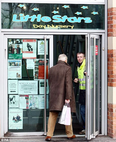 A visitor enters the Little Stars Nursery in Nechells, Birmingham this morning. It has been closed following Wilson's arrest