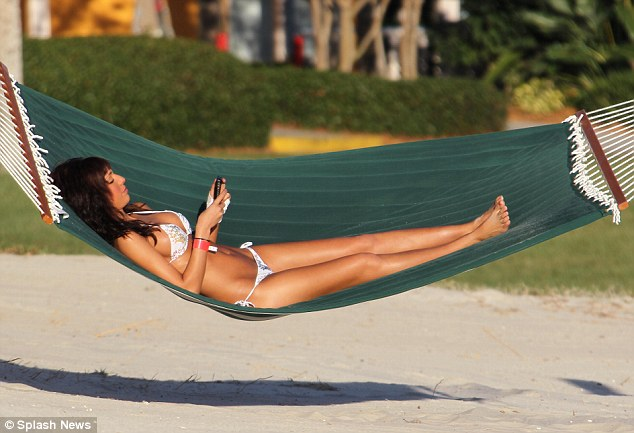 Taking a break: The single mother enjoyed some 'me-time' on a hammock