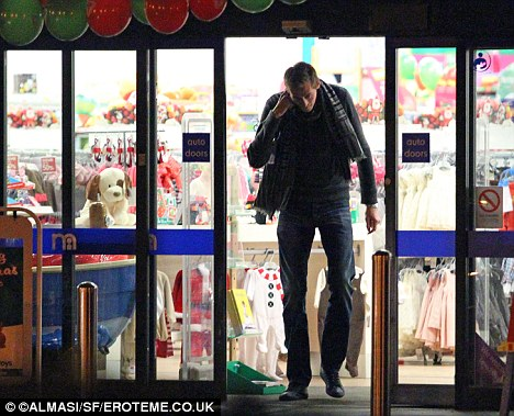 Just window shopping: Crouch leaves empty-handed and has to bend his 6ft 7in down through the doorway