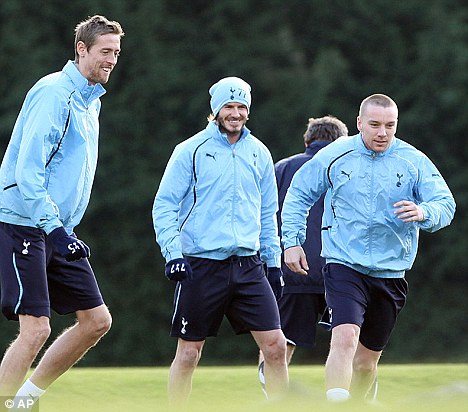 Football crazy: Crouch joins David Beckham and Spurs team mate Jamie O'Hara in training today