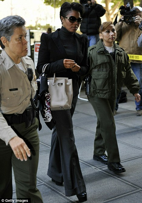 Escorted in: Janet Jackson was also in attendance and dressed in a black trouser suit