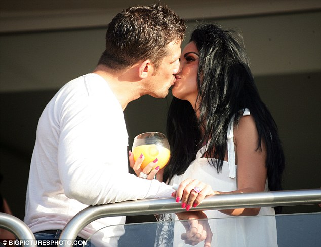 The look of love...? Price and Reid share a kiss in Spain after just a month of dating