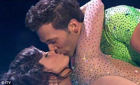Romance: Jennifer Metcalfe and Sylvain Longchambon kissed after their performance on Dancing On Ice last night