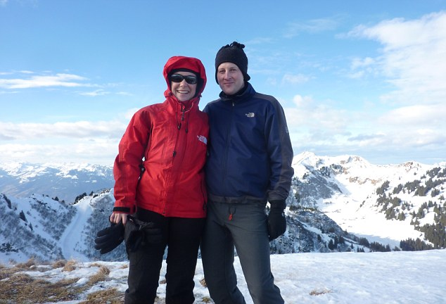 Becky and her husband Tom are pictured on a mountain in Villars