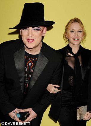 Still partying: Boy George with Kylie Minogue at the an exhibition opening in London on Tuesday