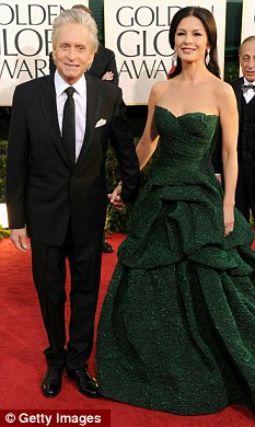 Hollywood star: Catherine with her husband Michael Douglas at the Golden Globe Awards on Sunday