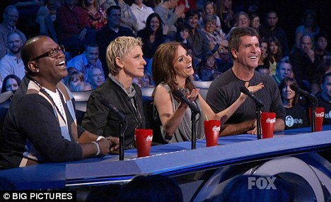 Real thing: Simon Cowell and the judging panel on American Idol with big red Coke glasses
